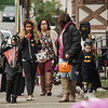 Trick-or-treaters work their way down Main Street during trick-or-treating in downtown Fitchburg on Saturday afternoon. SENTINEL & ENTERPRISE / Ashley Green