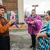 Maurice Eighme, of Circus Dynamics, twists up balloon animals for Danica and Tara Boivin during trick-or-treating in downtown Fitchburg on Saturday afternoon. SENTINEL & ENTERPRISE / Ashley Green