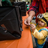 Tulah Pelletier, 2, gets some candy during trick-or-treating in downtown Fitchburg on Saturday afternoon. SENTINEL & ENTERPRISE / Ashley Green