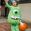 Layla Graf, 2, does her best Mike Wazowski during trick-or-treating in downtown Fitchburg on Saturday afternoon. SENTINEL & ENTERPRISE / Ashley Green