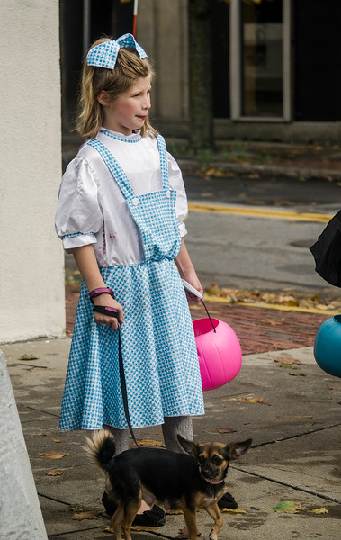 Delilah LaFontaine, 9, and her little Toto participate in the fun during trick-or-treating in downtown Fitchburg on Saturday afternoon. SENTINEL & ENTERPRISE / Ashley Green