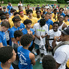 The second annual Sunny Side Foundation's Summer Throwdown three on three basketball tournament was held on Saturday, July 20, 2019 at Lowe Park in Fitchburg. Nino Hernandez, 20 with microphone, gathers all the players at center court to get the games underway. SENTINEL & ENTERPRISE/JOHN LOVE