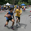 The second annual Sunny Side Foundation's Summer Throwdown three on three basketball tournament was held on Saturday, July 20, 2019 at Lowe Park in Fitchburg. Cristian Mendez tries to stop John Rodriguez, both of Fitchburg, as he drives to the net during their game. SENTINEL & ENTERPRISE/JOHN LOVE