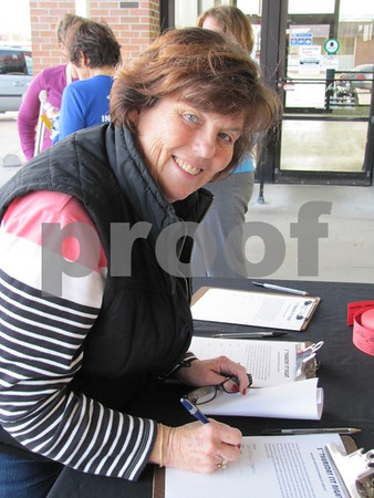 Dorothy Griffin registers for the walk/run.