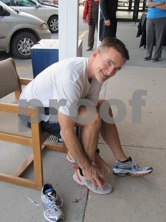 John Nanninga tries on a new pair of shoes at Brown's Shoe Fit.