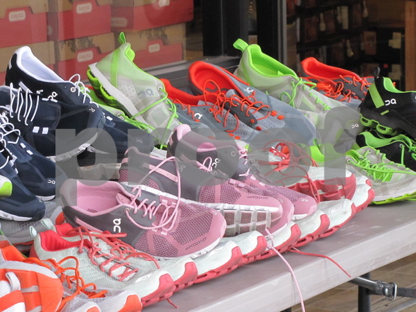 Rainbow of colors of running shoes available at Brown's Shoe Fit.