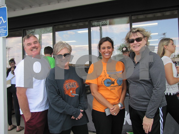 Joe Abrams, Shari Burke, Shaunna Abrams, and Shelly Stanek are ready to take part in the walk for fitness sponsored by Brown Shoe Fit.