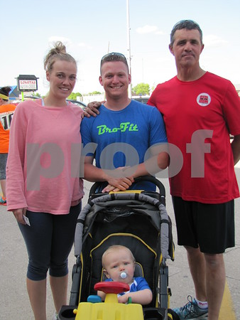 Stephanie and Eddie Elkin, Larry Shivers, and Fisher Elkin in the stroller participated in the Third Thursday Fit Night at Brown Shoe Fit.