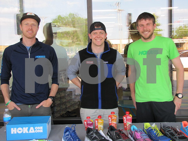 Alex Kurt and Ryan Bailey, representatives for HOKA shoes, and Aaron Schmidt of Brown Shoe Fit.