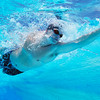 Underwater shot of professional male athlete swimming in pool