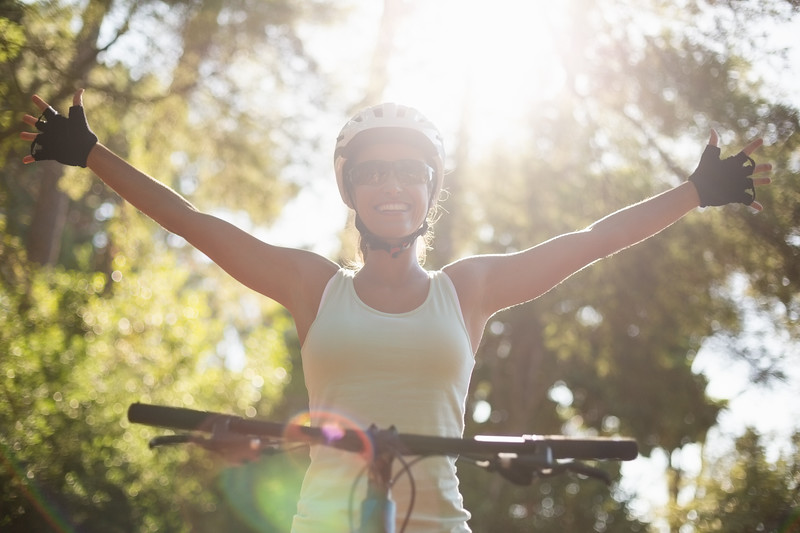 Woman rider smiling and throwing arms