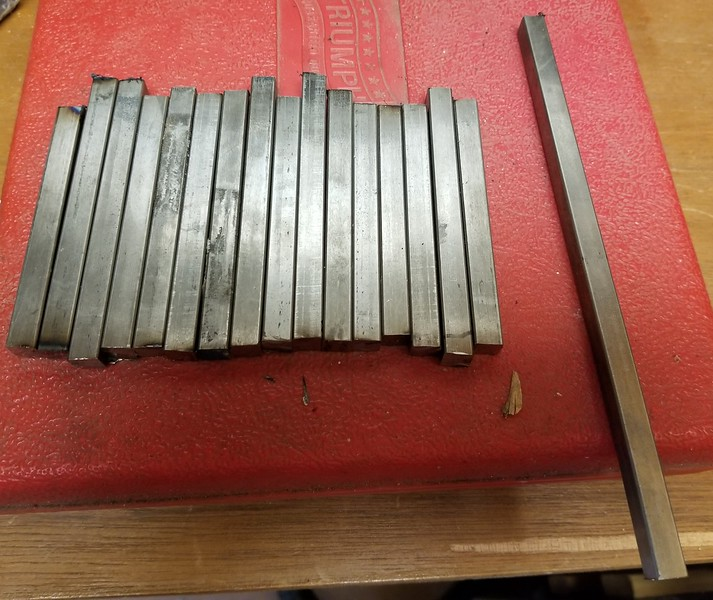 "8/3/2020: These are 3/8"" x 3/8"" steel bars, cut from two 36"" bars from Home Depot that will be used for spacers. The 1/2"" bars that I bought would not fit between the mounting bolts and the outer edge of the shock mount. As it turned out, I have TWICE as many little bars than I needed... oh well, they weren't expensive.."