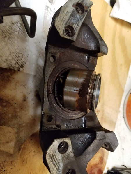 "Rust everywhere. When I rebuilt them before, I did not use ""caliper assembly grease"". I just assembled with brake fluid. Mistake #1."