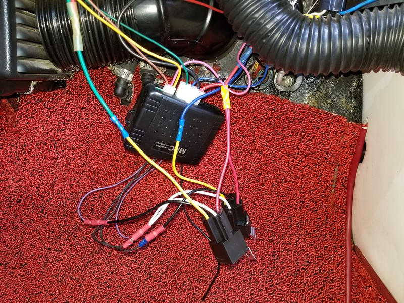 External wiring completed and ready to see if this works, The board mounted relays do nothing now. Notice that the RED power wire that feeds both the electronics and the power source for the relay contacts are all tied together, and the output wires in the large white plug have been removed and connected to the contact power inputs for the new relays. The power outputs from the relays are now connected to the feed for each solenoid inside the doors.