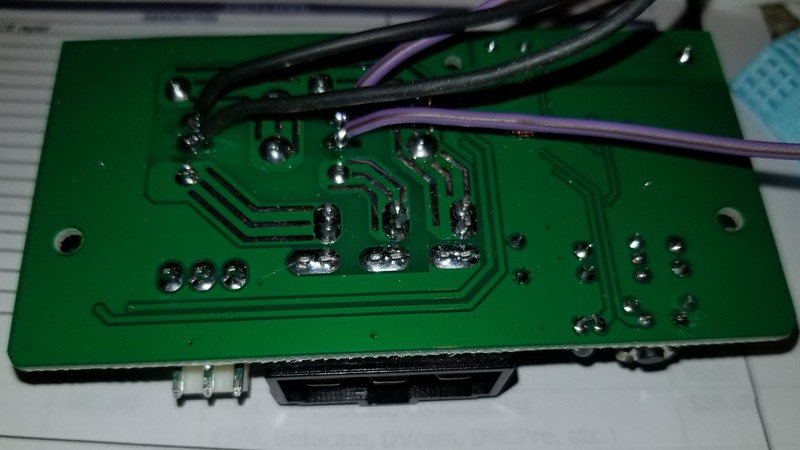 Four wires soldered to the two holding coil connections to energize two external relays. There is a potential problem with leaving the old relays in place. The PCB has triacs or whatever you call them, to trigger the original relays. By adding the external relays, those triacs then will see BOTH holding coils, possibly overloading and burning out those electronic devices.