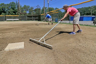 Fixing up Softball field in Leominster, July 18, 2018