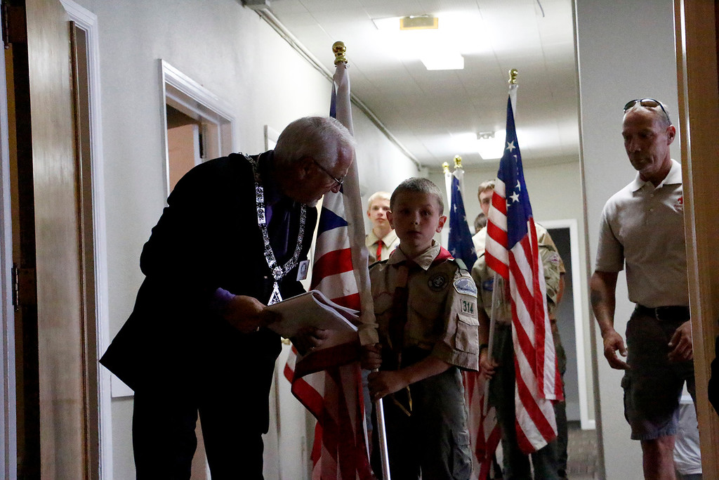 . Ted Ullmann, Inner Guard for the Elks, directs Erik Aeling, 10, of boy scout troop 314 as Aeling prepares to present the Grand Union Flag at the Elks Lodge 1051 on Wednesday evening, June 14, 2017. The Elks arranged a Flags Day ceremony to respectfully retire ragged flags. (Michelle Risinger/ Loveland Reporter-Herald)