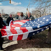 Mayor Stephen DiNatale joined a group on the Upper Common in Fitchburg on Friday, March 3, 2017 to raise a series of 27 new flags donated to the city by a group of local business owners. SENTINEL & ENTERPRISE / Ashley Green
