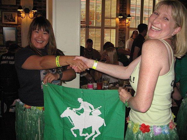 Hope for getting the Flag to Hawaii had been all but lost. But at the 11h hour, OutlandoGirl discovered fabulous Flag Mule Shig, who swooped in enthusiastically to save the day.<br /> <br /> The Passing of the Flag: Shig, OutlandoGirl<br /> <br /> <br /> (photo courtesy of Donna)