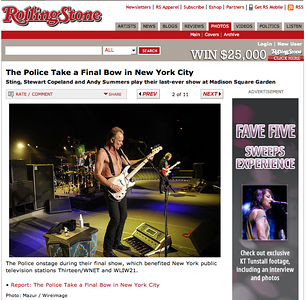 "On 8/21/08, RollingStone.com posts a recap/review of the Police finale titled ""The Police Say Farewell With New York Blowout,"" scheduled to be printed in the September 4, 3008 issue (#1060). Accompanying the article is a photo gallery (whose title matches a recap/review posted on 8/7/09 but does not seem to accompany it) in which the Flag rears its ugly head.   (screencap, http://www.rollingstone.com/photos/gallery/22494260/the_police_take_a_final_bow_in_new/photo/2 )"