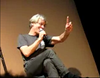 """Just the one.""<br /> <br /> March 2008: During the Q&A portion of ""An Evening With Stewart Copeland"" at the Savannah Music Festival, Stewart talks publicly about the Flag for the first time -- even though 95% of the audience have absolutely no clue what he's blathering on about.<br /> <br /> <br /> (screencap from video courtesy of bella)"