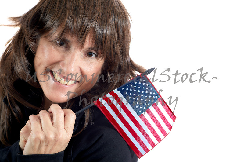 Mature Woman waving an American Flag