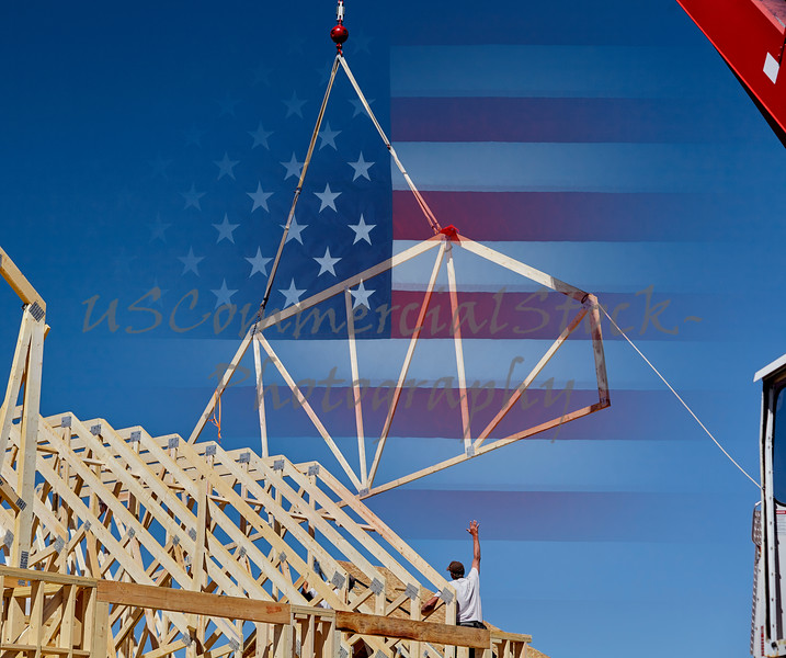 Man carpenter reaching for roof truss USA flag American Jobs