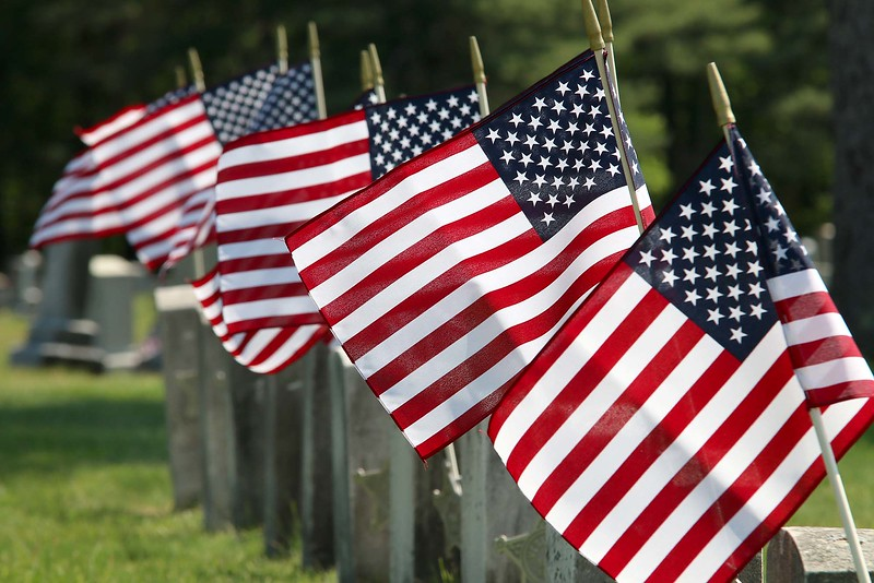Flags where placed on veterans graves at Forest Hill Cemetery on Thursday afternoon. SENTINEL & ENTERPRISE/JOHN LOVE