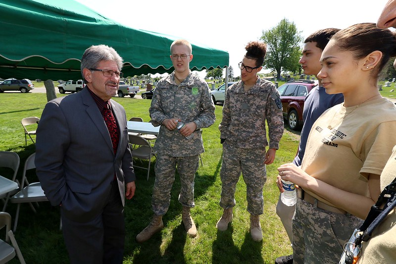 Just before going out to put flags on veterans graves on Thursday afternoon Students in the Fitchburg High School JROTC chated with mayor Stephen DiNatale. From left is DiNatale with students Mark Broughton, Edwin Machado, Hector Nieves and Iris Negron. SENTINEL & ENTERPRISE/JOHN LOVE