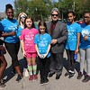 Fitchburg Mayor Stephen DiNatale poses with students from the Memorial Middle School Girls on the Run program just before they went out to put flags on veterans graves. From left is students Faith Labah, Adriana Sanatana Novas,  Teacher Christen Sachse, students Athena William, Rebecca Palmer, DiNatale, Suha Waqar and Dominique Souffrant.  SETNINEL & ENTERPRISE/JOHN LOVE