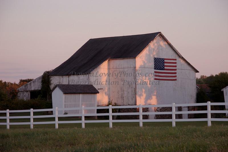 White Barn and Flag at Dusk