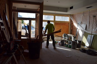 Construction workers inside the Flagstar Strand Theatre for the Performing Arts on Wednesday, Oct. 19, 2016.