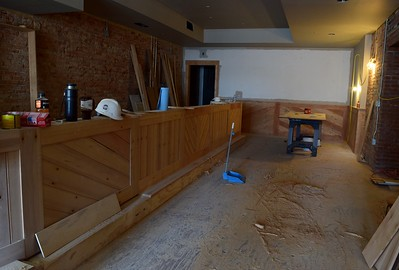A bar area, made from reclaimed wood from Pontiac High School, inside the Flagstar Strand Theatre for the Performing Arts on Wednesday, Oct. 19, 2016.