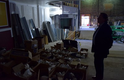 Bill Lee, president and CEO of the theater, looks at potential paint colors for the inside of the Flagstar Strand Theatre for the Performing Arts on Wednesday, Oct. 19, 2016.