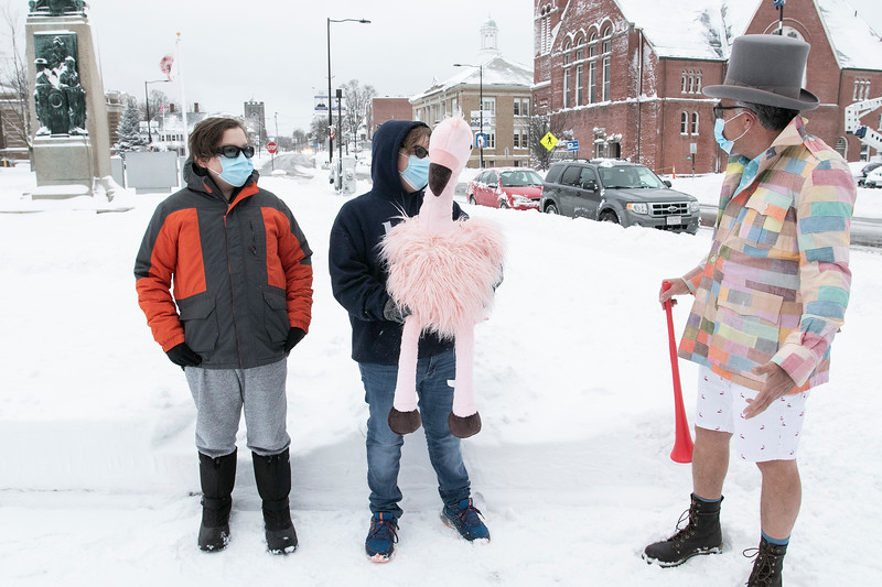 Leominster Mayor Dean Mazzarella was the master of ceremonies at the annual Flamingo Day in the City on February 2, 2021. Helping out the mayor during the ceremony is, from left, Sean Joffrion, 13, and Tommy Joffrion, 14. SENTINEL & ENTERPRISE/JOHN LOVE