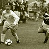 MIKE DOWD/P-R FILE PHOTO<br /> <br /> Plattsburgh State's Laura Ray (26) tries to move away from Cortland's Holli Mulholland (21) during a SUNYAC women's soccer game Sept. 22, 1995.
