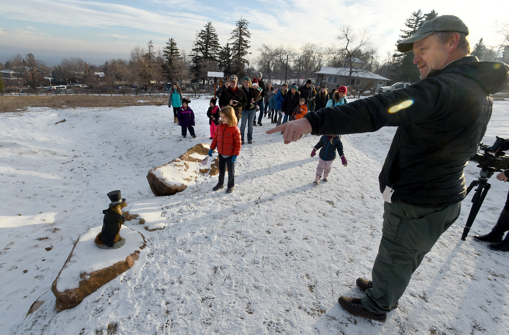 . City of Boulder Open Space and Mountain Parks Ranger, Dave Gustafson, right, points out Freddy\'s shadow. Flatiron Freddy, Boulder\'s answer for Groundhog Day,  made his annual appearance at Chautauqua Park on Friday and did see his shadow. For more photos and a video, go to dailycamera.com. Cliff Grassmick  Photographer  February 2, 2018