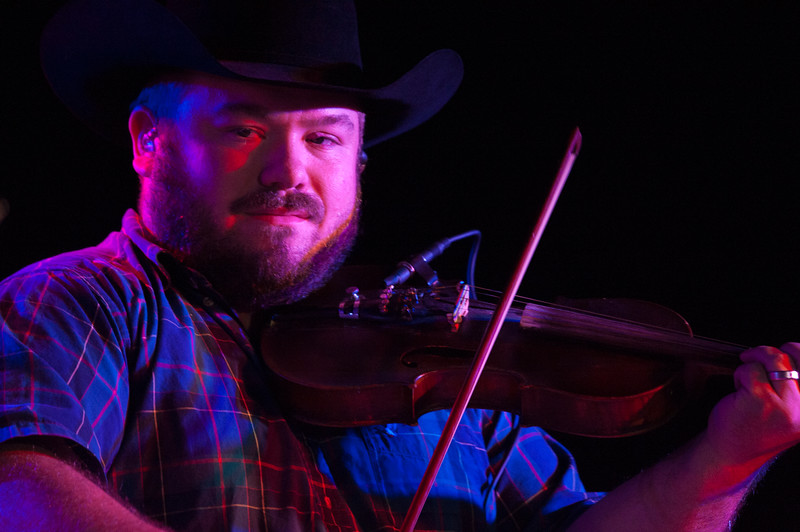 Wesley Hall performs at The Hat in Manhattan, Kan. on Oct. 20, 2017. Hall plays fiddle for the band. Formed in 2012 they released its most recent album, Humble Folks, in 2016. (Photo by Justin Wright | Collegian Media Group)