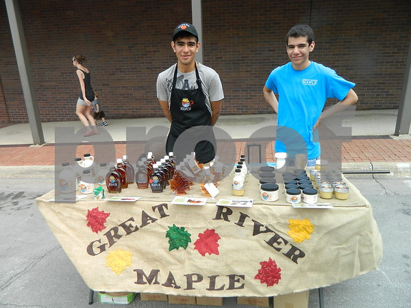 Ricky and John Ramirez selling delicious Great River Maple products.