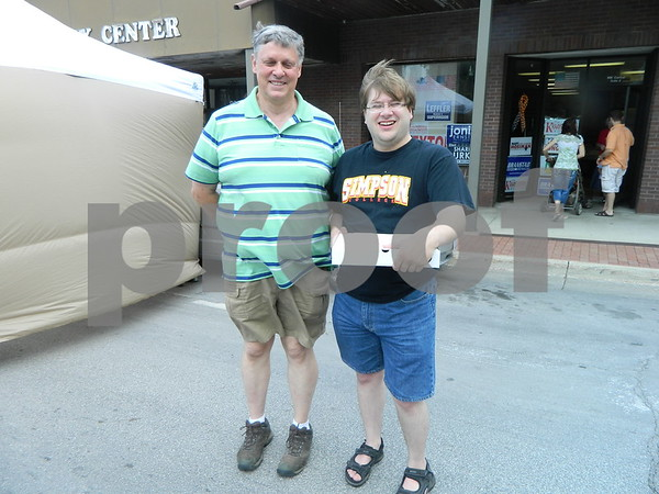 Kim Alstott and Peter Kaspari enjoying the windy day at market on central.