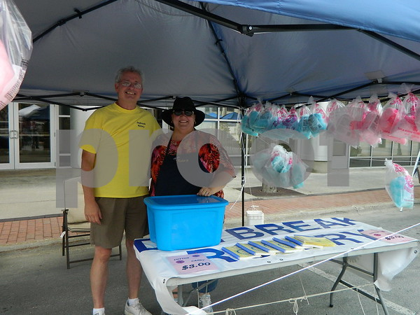 Letitia Christnagel and Gary Moore making the children's day with cotton candy