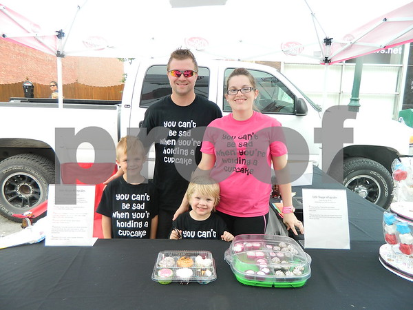 Right to left: Keri Froisland, Kirk Froisland, Kaden Froisland and Karson Froisland selling their treats at market on central.