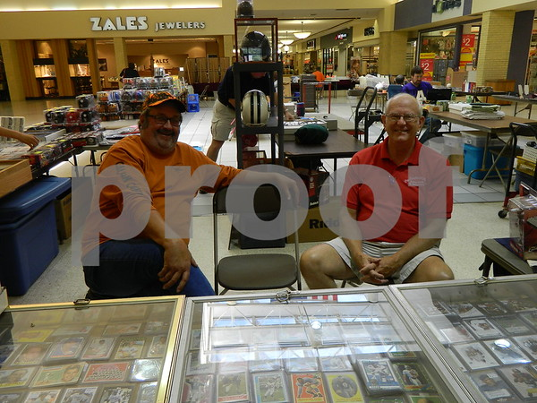 Left to right: Max Carlson and David Jensen selling some sports cards and memorabilia.
