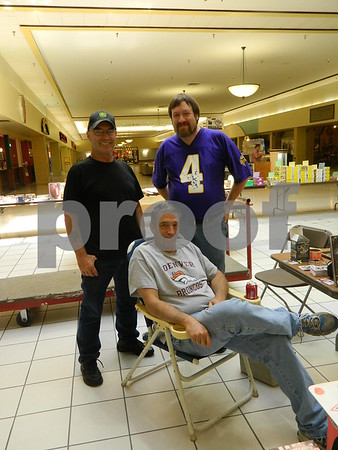 Left to right: Rik Mallin, Scott Hilbert and Jim Jordan also selling sports cards and memorabilia.