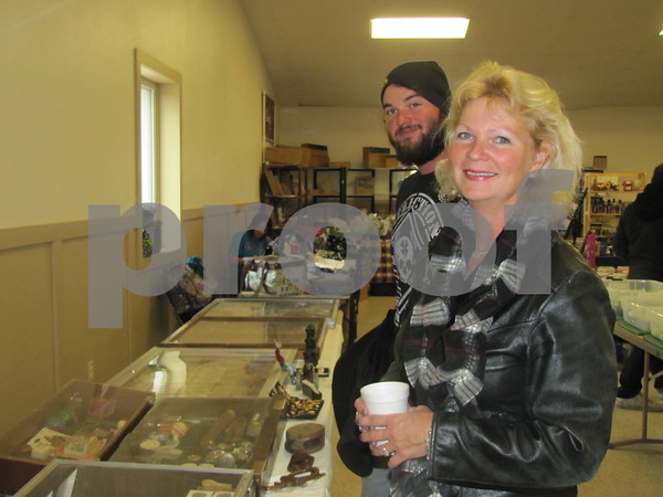Daniel Hagen and his mother Linda Beck look over rare items at the flea market.