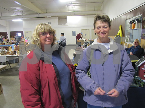 Judy Sorenson and Pat Appleton enjoy the day browsing the flea market.
