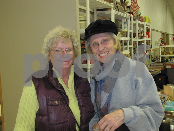 Kim Sattizahn and Janet Carlson enjoy the day browsing the flea market.