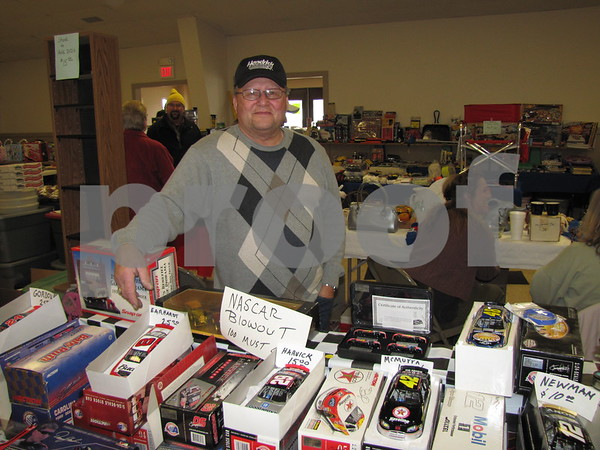 Brad Strutzenberg of Humboldt with his collectible cars at the Winter Flea Market.