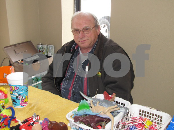 Ben Smith of Manson sits at his booth at the Winter Flea Market at the Webster County Fairgrounds.