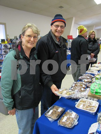 Sharon and Dave Hrubes look over some of the baked goods for sale at the Winter Flea Market at the Webster County Fairgrounds.
